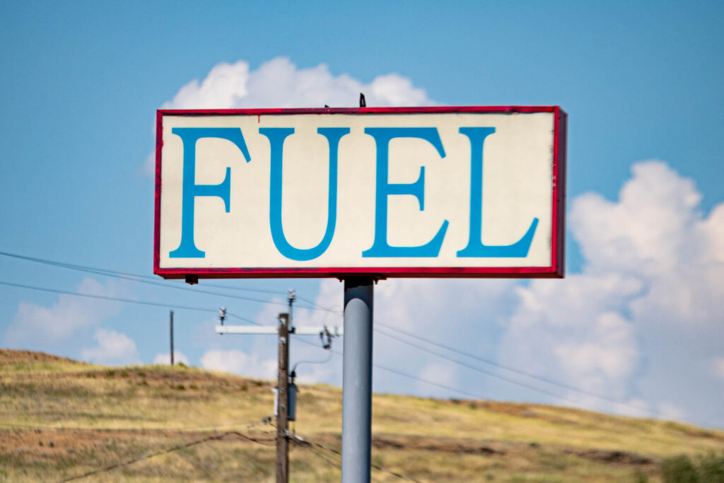 A Fuel sign that could be from a model railroad rises above the parched ground in Washtucna, Washington. The off-brand store gas station provides the only major services in town.