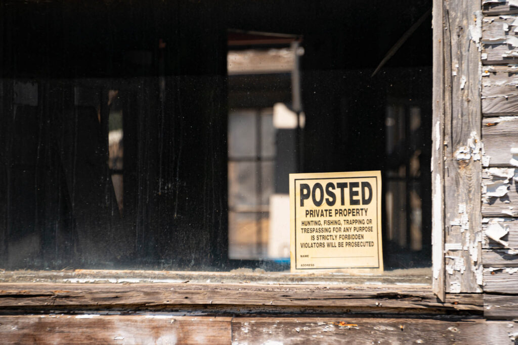 A No Trespassing sign in Washtucna, Washington guards a building with no contents and no value.