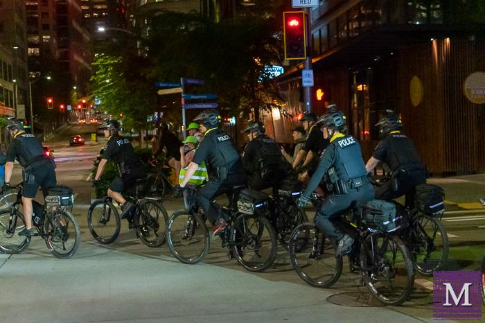 Seattle Police follow and arrest protesters on April 20, 2021